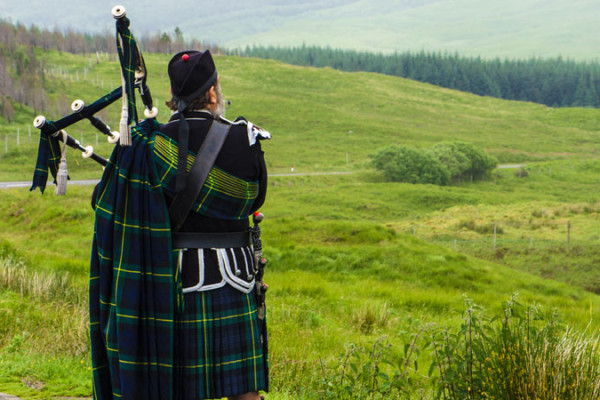 Bagpiper in the Highlands